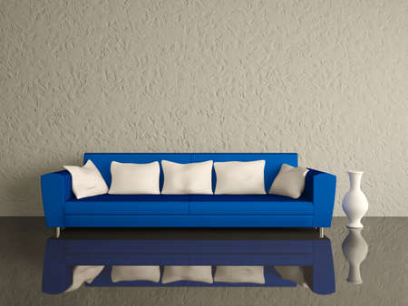 Blue sofa with white pillows and a vase near a wall photo