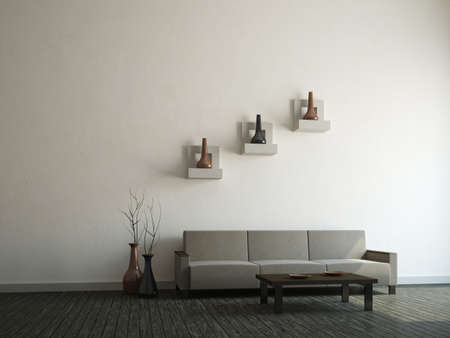 Gray sofa and vases near a wall photo
