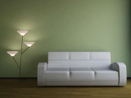The sofa and the lamp near a wall photo