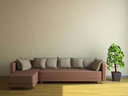 The sofa and the plant near a wall Stock Photo - 14176614