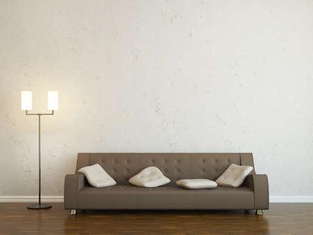 divano: Divano in pelle e una lampada vicino al muro