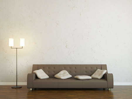 couch: Leather sofa and a lamp near the wall