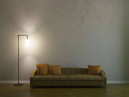 Sofa and a lamp near the wall Stock Photo
