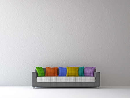 Sofa with color pillows near the wall photo