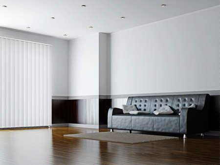 livingroom: Black sofa with a white pillows near the wall