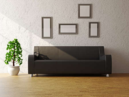 Black leather sofa and a plant near the wall photo
