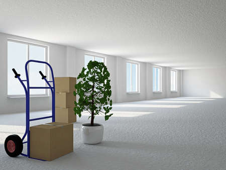 trasloco: Sala vuota con scatole e carretto vicino alla finestra Archivio Fotografico