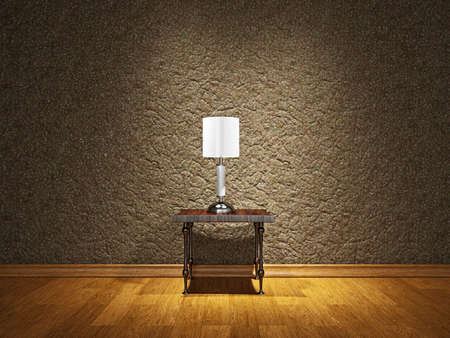 Lamp on the table near a cement wall photo