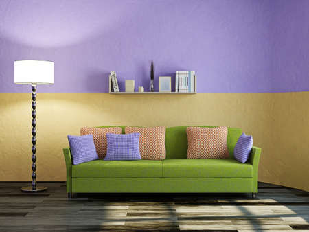 Green sofa and lamp near a plaster wall photo