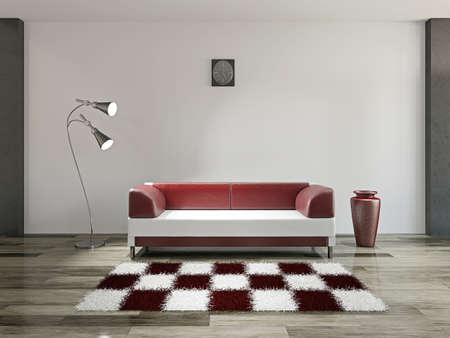 Sofa and lamp near a white wall