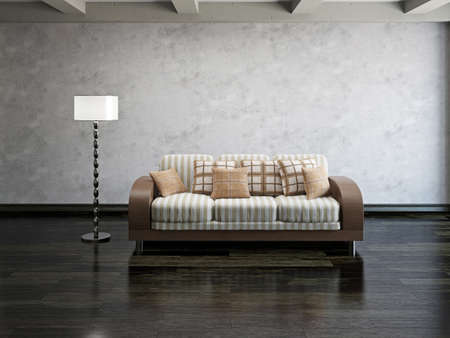 Sofa and lamp near the cement wall photo