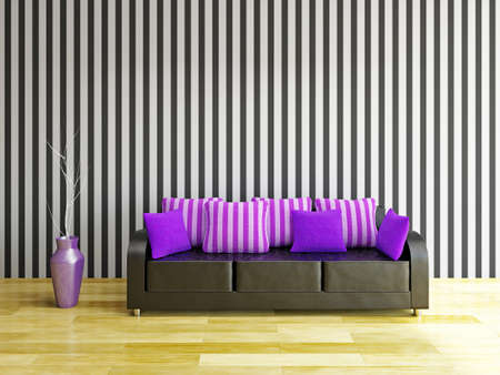 Leather sofa with violet pillows near a wall Stock Photo - 22494967