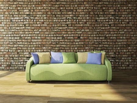 cushions: Sofa with cushions against the wall Stock Photo