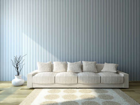 Sofa with cushions near the wall photo