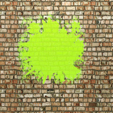 Blot of green paint on a brick wall photo