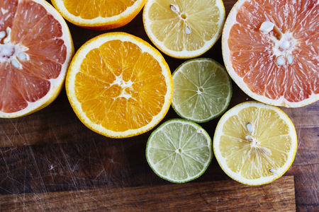 high section: Sliced citrus fruits on chopping board LANG_EVOIMAGES