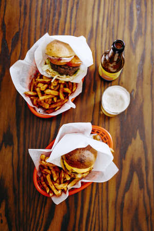 unfit: Directly above shot of fast foods served with beer on restaurant table