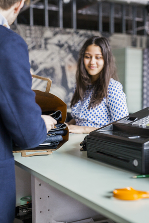 purchasers: Young woman buying jeans from factory LANG_EVOIMAGES