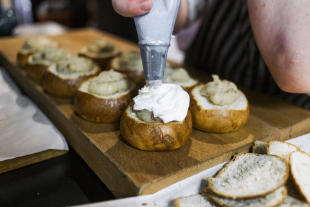 unhealthful: Cropped image of chef icing buns in kitchen