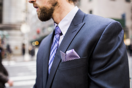 business: Midsection of well-dressed businessman standing on city street LANG_EVOIMAGES