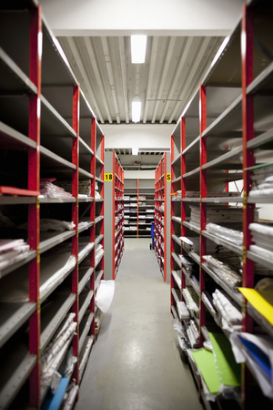 verticals: Files on shelf in store room
