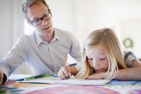 Father and daughter doing homework LANG_EVOIMAGES