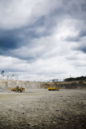 gravel pit: Working vehicle in gravel pit LANG_EVOIMAGES