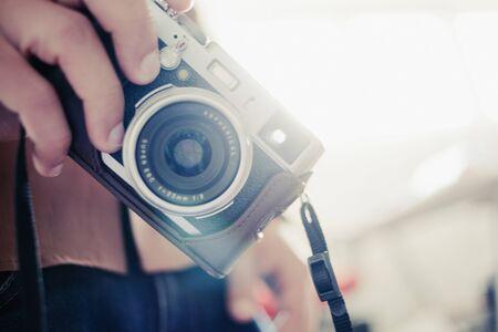 appendage: Close-up of hand holding a nostalgic camera LANG_EVOIMAGES