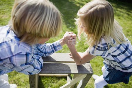 Siblings competing