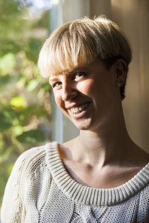 verticals: Portrait of happy young woman