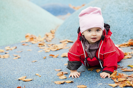 Portrait of baby girl crawling at park LANG_EVOIMAGES