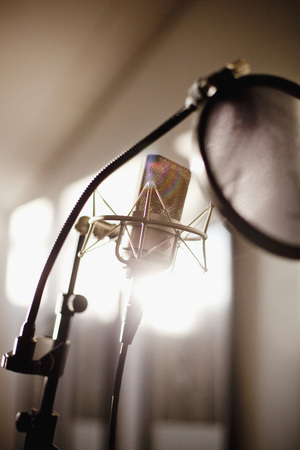 Close-up view of microphone in recording studio