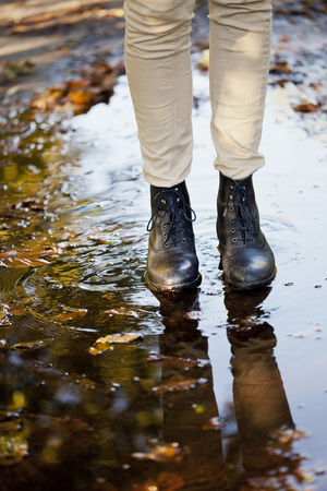 verticals: Young woman standing on wetland