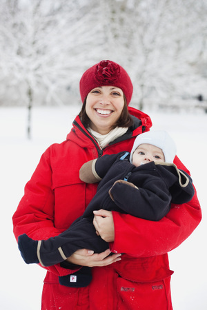 Women with baby in bossom LANG_EVOIMAGES