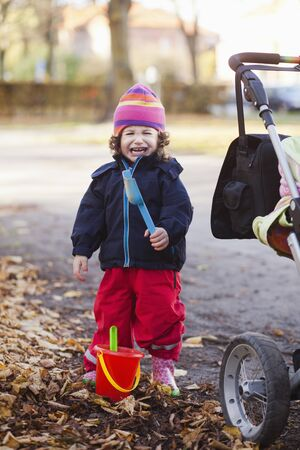 leafed: Baby girl with gardening toys crying at park