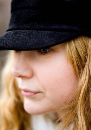 Girl with peaked cap LANG_EVOIMAGES