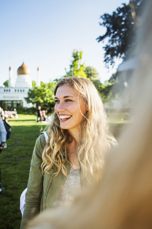 beings: Happy woman looking away while standing at park