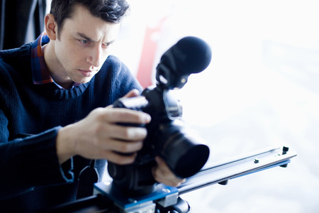 beings: Serious young male photographer with his camera