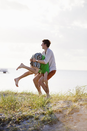 Playful male friends at beach