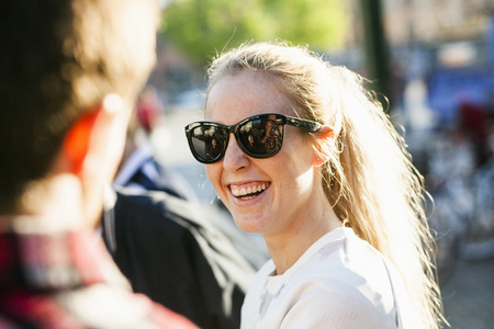 Happy young woman wearing sunglasses outdoors