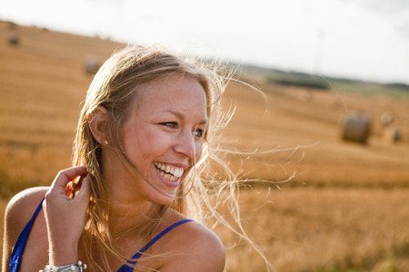 beings: Happy young woman looking away at field