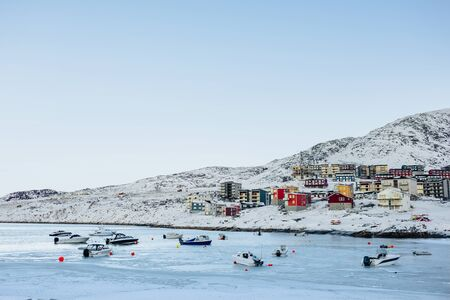 nuuk: Frozen sea with residential buildings