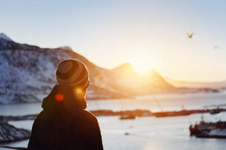 nuuk: Man looking at view at sunset LANG_EVOIMAGES