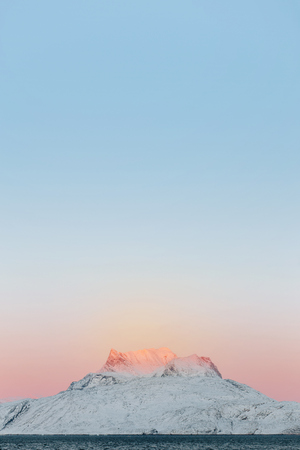 nuuk: Snowcapped mountain against clear sky at sunset LANG_EVOIMAGES