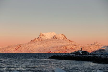 nuuk: Snowcapped mountain and sea at sunset LANG_EVOIMAGES