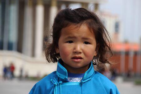 mongolian: Mongolian boy wearing traditional dress Sukhbaatar Square, Ulaanbaatar