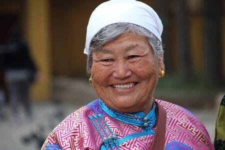 mongolian: Mongolian woman wearing traditional dress Gandan monastery Ulaanbaatar