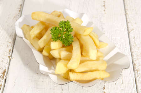 french fries with parsley in a paper bowl photo