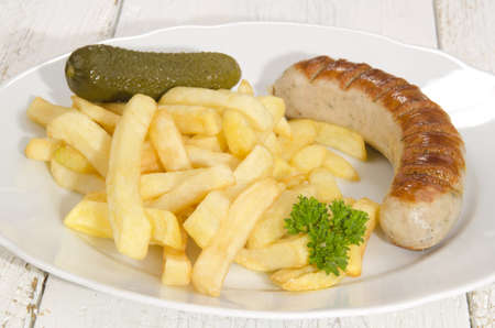gherkin: french fries, gherkin and grilled sausage