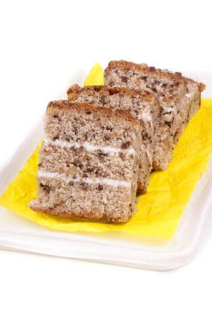 silken: walnut cake with cream filling on a yellow silken napkin